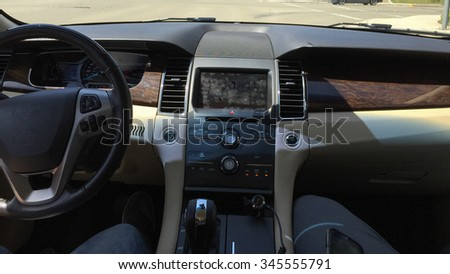 Badly stained with fingerprints touch screen of modern car control display - stock photo