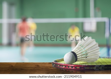 badminton - badminton courts with players competing - stock photo