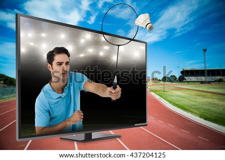 Badminton player playing badminton against american football arena - stock photo