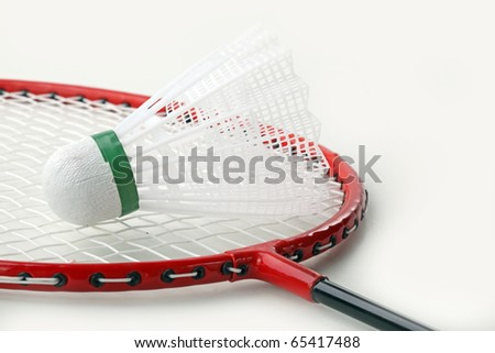 Badminton rackets and shuttlecock isolated on white background - stock photo