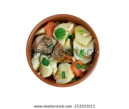 Baeckeoffe - ypical dish from  French , Germany.mix of sliced potatoes, sliced onions, cubed mutton, beef and pork  - stock photo