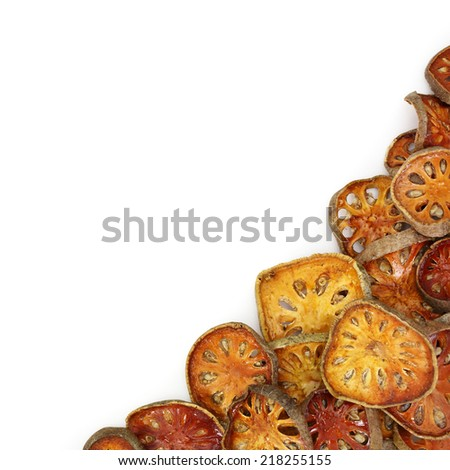 Bael fruit dried isolated on white background