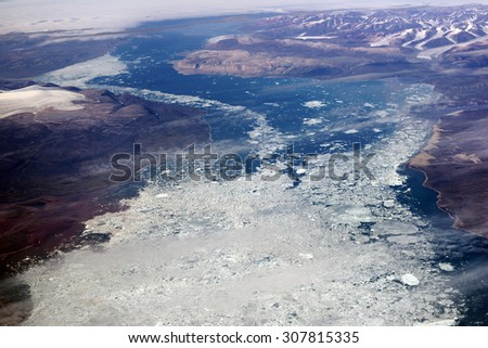 Baffin Island, aerial view from 12,000 metres, Nunavut, Canada - stock photo
