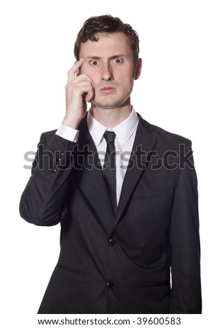 baffled businessman in a black suit scratching his head - stock photo