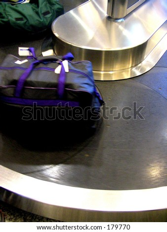 Bag at airport luggage tape - stock photo