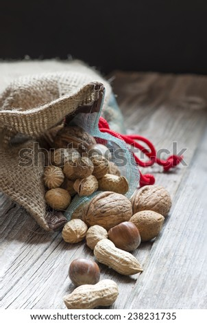 Bag full of bio nuts and almonds - stock photo