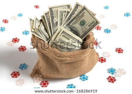 Bag full of money / studio photography of bag with hundred dollar bills  - stock photo