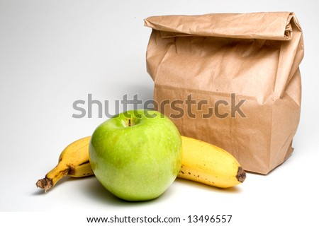Bag lunch with a banana and an apple. - stock photo