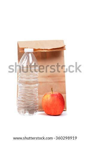 bag lunch with water and apple isolated on white background - stock photo