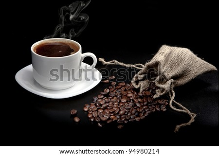bag of coffee beans and a cup of coffee - stock photo
