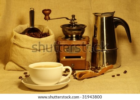 Bag of coffee beans,Coffee grinder and Coffee maker