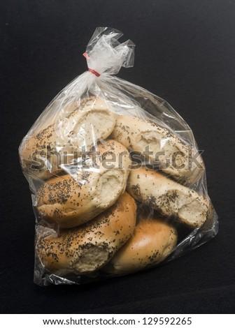 bag of 1/2 dozen freshly baked poppy seed bagels - stock photo