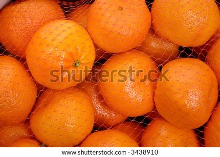 Bag of Mandarin Oranges in Netting - stock photo