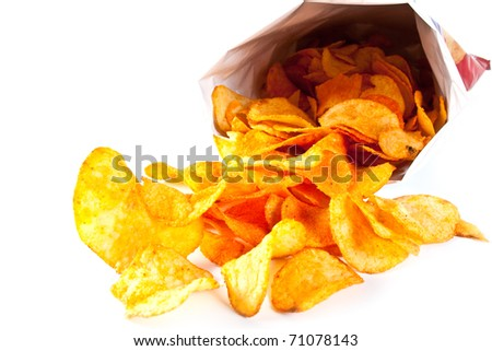 Bag of Potato Chips. Potato chips poured out from packing on a white background - stock photo
