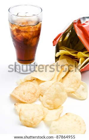 Bag of potato chips with soda on white background - stock photo