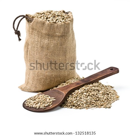 bag of rye and a wooden spoon on a white background. keeping paths - stock photo