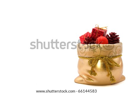 bag of Santa Claus with gifts and christmas tree toys isolated on white background - stock photo