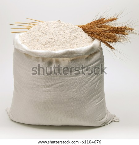 Bag of whole flour with bunch of wheat on white background - stock photo