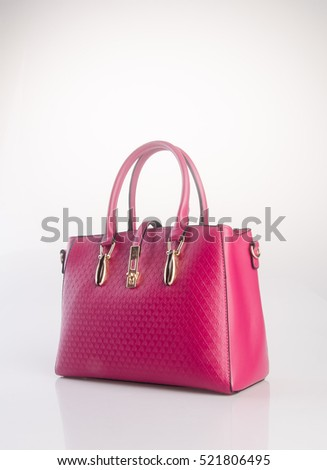 bag or red colour woman bag on background