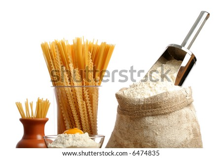 Bag with a flour and macaroni, isoleted on white - stock photo