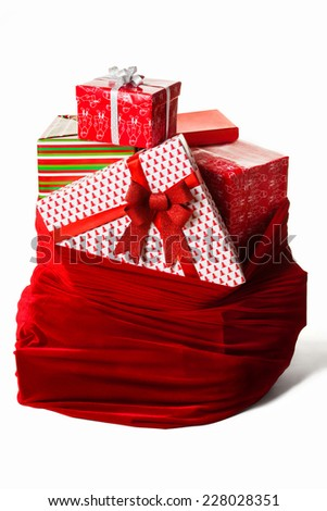 Bag with christmas presents isolated - stock photo