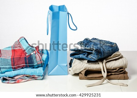 Bag with colorful clothes on a sales counter