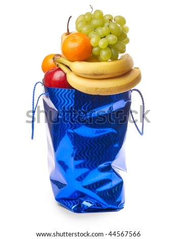 Bag with fruits isolated on white - stock photo