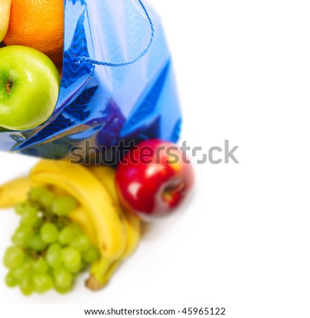 Bag with fruits over white. Focus on green apple - stock photo