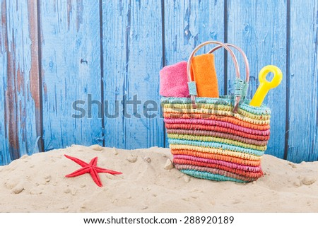 Bag with towels at the beach - stock photo