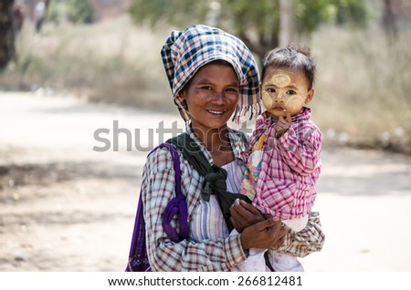 stock-photo-bagan-burma-feb-nice-parent-and-kid-with-kindness-to-tourists-266812481.jpg