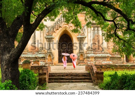 BAGAN MANDALAY MYANMAR NOVEMBER 2014 : Nuns walking inside Sulamani temple bagan Myanmar 10 November 2014  - stock photo