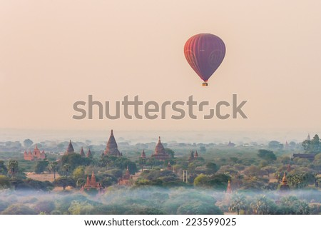 BAGAN, MYANMAR - CIRCA MARCH 2014 : Hot air balloons fly over Bagan, recognised as UNESCO world heritage, in circa March 2014 in Bagan, Myanmar - stock photo