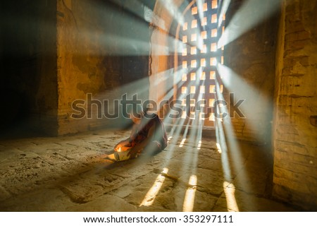 BAGAN, MYANMAR - DEC 10, 2015: Unidentified Buddhism neophyte prays in Buddihist temple on December 10, 2015 in Bagan, Myanmar. Southeast Asian neophyte praying in a Buddihist temple - stock photo