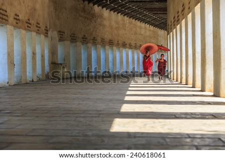 BAGAN, MYANMAR - DEC 6: Unidentified young Buddhism novices at Shwezigon temple on Dec 6, 2014 in Bagan. Buddhism is predominantly of the Theravada tradition, practised by 89% of the population. - stock photo