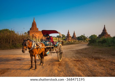 Bagan, Myanmar-DECEMBER 31, 2013: A horse cart is waiting for tourists in a famous destination of Myanmar. - stock photo