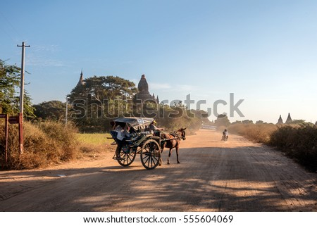 Bagan, Myanmar - 31 December 2016 - Horse cart on the road in Bagan. It is an ancient city located in the Mandalay Region of Myanmar .