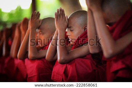 BAGAN - MYANMAR - DECEMBER 11, 2013: Unidentified Burmese novices on December 11, 2013 in Bagan, Myanmar. In 2012 an ongoing conflict started between Buddhists and Muslims in Myanmar. - stock photo