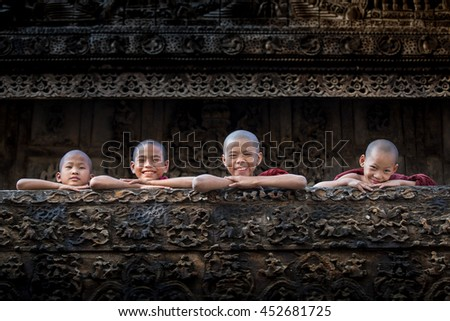 BAGAN, MYANMAR - Feb 18, Monk is smiling with light inside pagoda on Feb 18, 2015 in Bagan. Monks with light and Buddha are highlighted of Bagan.
