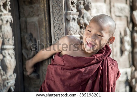 BAGAN, MYANMAR - JAN 6: Unidentified young Buddhism novices at Shwezigon temple on JAN 6, 2016 in Bagan. Buddhism is predominantly of the Theravada tradition, practised by 89% of the population. - stock photo