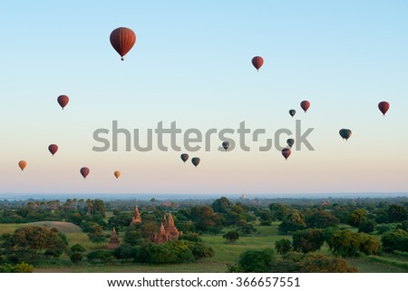 BAGAN, MYANMAR - NOVEMBER 24 : Colourful hot air balloons float over the temples of Bagan on November 24, 2015 in Bagan,Myanmar - stock photo