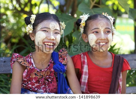 BAGAN, MYANMAR - OCT 15: Unidentified Burmese children wearing traditional Thanaka face cream in Bagan, Myanmar on October 15, 2011. Thanaka face cream has been used by Burmese for over 2000 years. - stock photo