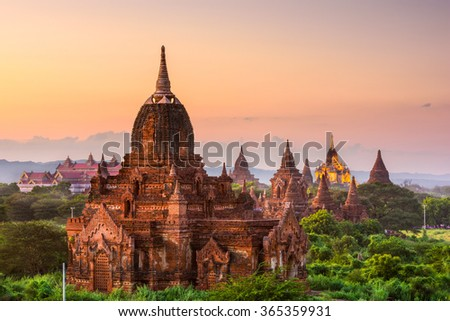 Bagan, Myanmar temples in the Archeological Park at dusk. - stock photo