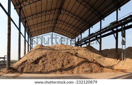 Bagasse is the fibrous matter that remains after sugarcane or sorghum stalks are crushed to extract their juice. Bagasse is used as a biofuel and in the manufacture of pulp and building materials - stock photo