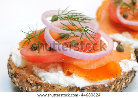 Bagel and Lox. Smoked salmon, cream cheese, tomato, red onion, capers and dill. - stock photo