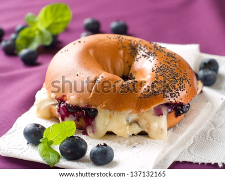 Bagel with cheese and barry, selective focus - stock photo