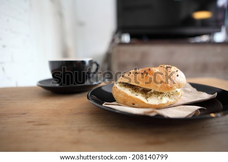 bagel with coffee - stock photo