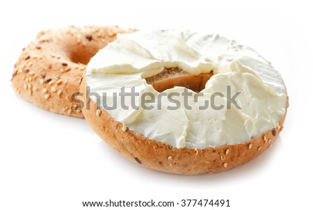 Bagel with cream cheese isolated on white background - stock photo
