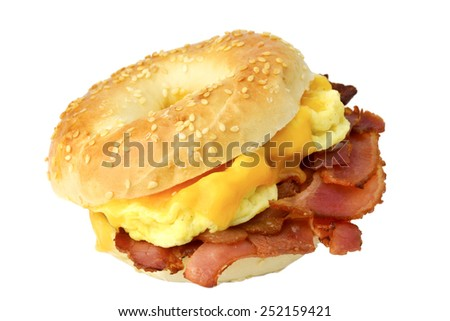 Bagel with fried bacon, scrambled eggs and cheddar cheese, studio isolated. Breakfast sandwich - stock photo
