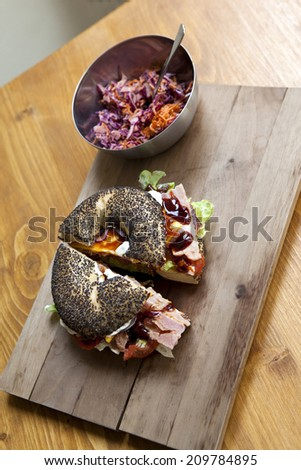 Bagel with ham, vegetable and salad - stock photo