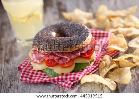Bagel with Salami - stock photo